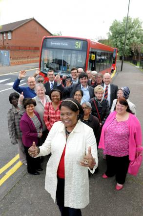 Councillor Edith Macauley celebrates the new bus route with residents