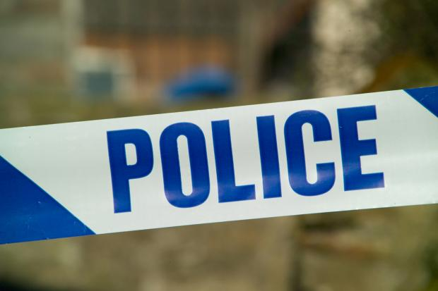 A man has been arrested for attempted murder after an attack on two people in Hook Road, Epsom