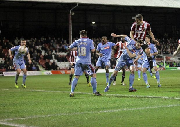 Sutton Guardian: Head strong: Brentford defender James Tarkowski, right, volleyed home from close range in the first half