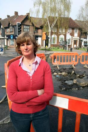 Cheam Councillor Mary Burstow at the site of the leak