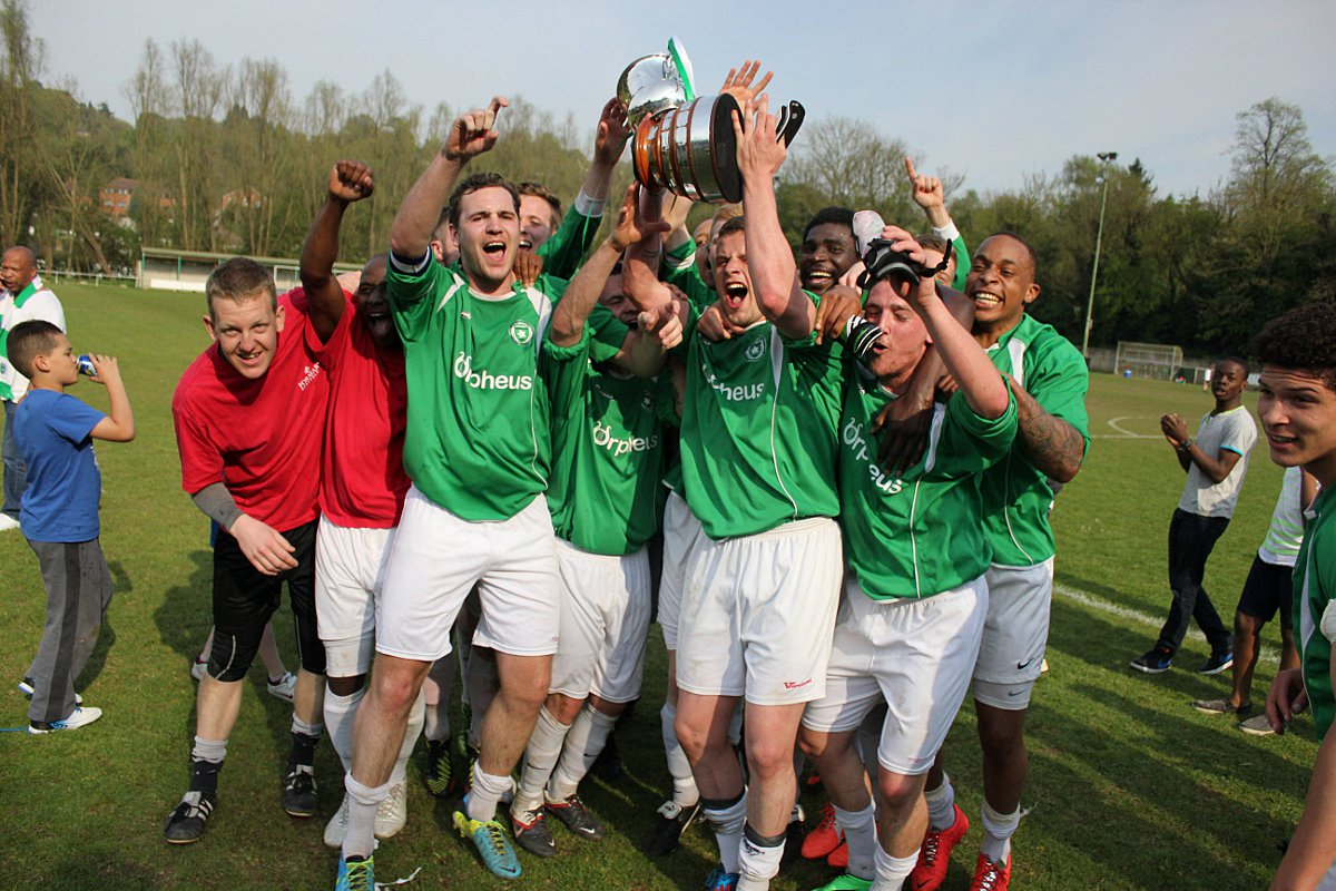Make the most of it: The Whyteleafe players get the promotion party started