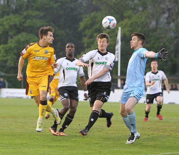 Sutton Guardian: Not this time: Jamie Taylor gets his head to the ball only to see it drop wide