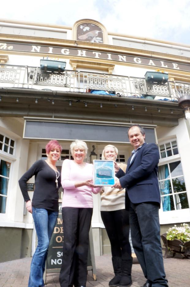Sutton Guardian: Paul Scully presents the prize to staff from the Nightingale