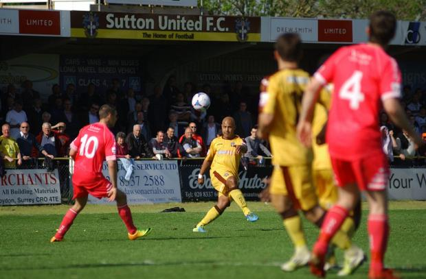 Not this time: Simon Downer and Sutton United face another season in the Skrill South after the disappointment of defeat on Saturday                   SP84841-14