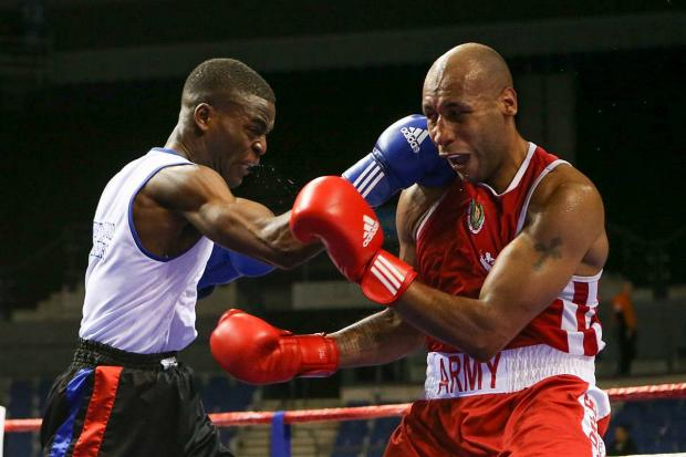 Unstoppable: Joshua Buatsi, left, defeating Tom Barry in the semi-finals of th