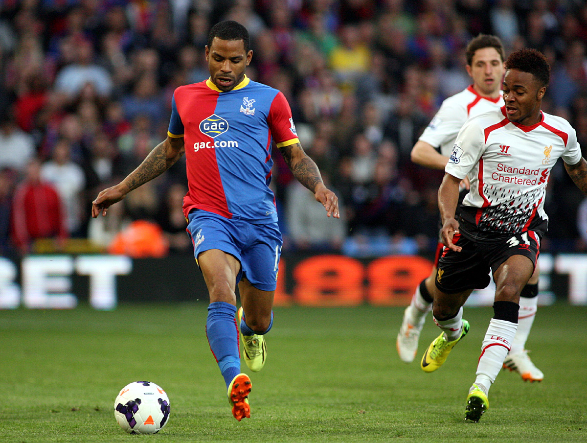 Sutton Guardian: Jason Puncheon tries to get away from Raheem Sterling