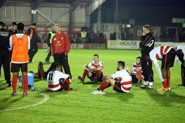 Lottery losers: Kingstonian have that sunk feeling after losing in the Ryman Premier League play-off semi-final              SP84724