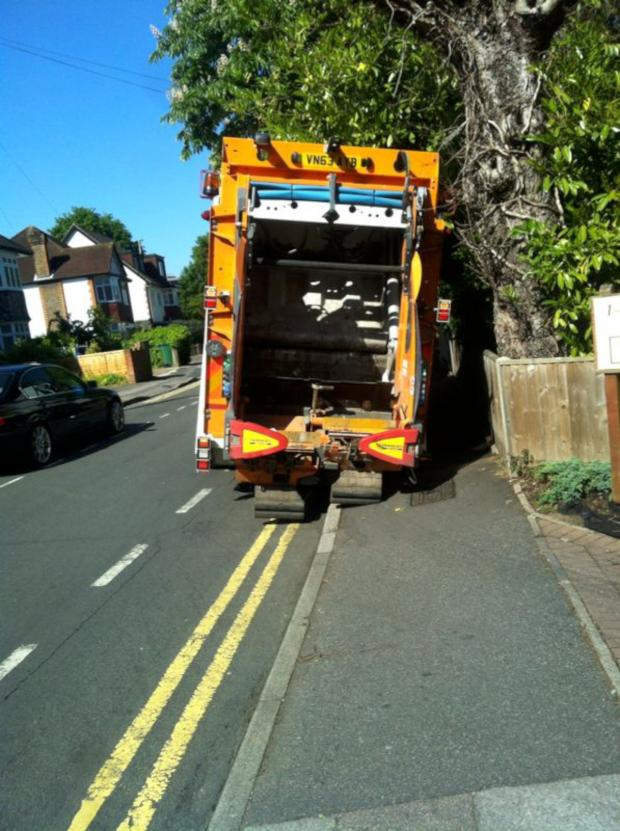 Sutton Guardian: SUTT YELL: Bin lorry stuck in Sutton town centre pot hole