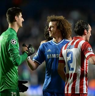 Thibaut Courtois, left, spent time away from Chelsea last season