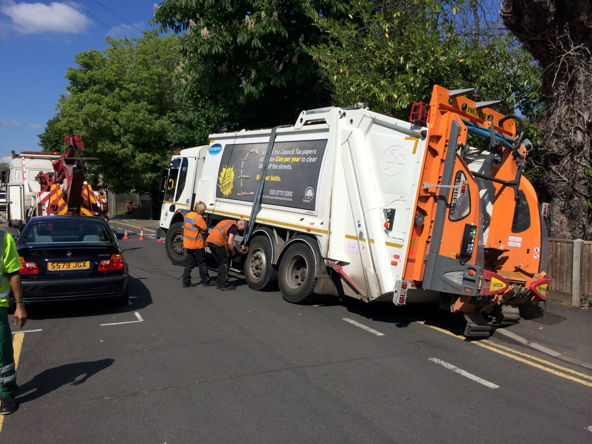 VIDEO: Bin lorry stuck in sink hole