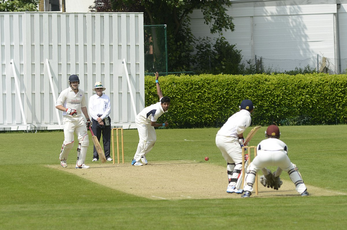Man of many talents: Ex-Tiffin School student Arun Harinath sends one down for Sutton against Weybridge at the weekend