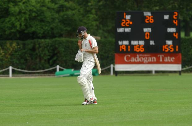 Gone: Wimbledon skipper Chris Benham trudges off after being trapped LBW by Spencer's Alex Tudor