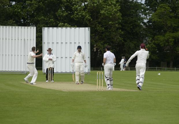 Early exit: Teddington bowler Harry Bush appeals for the wicket of former England Test star Mark Ramprakash on Saturday