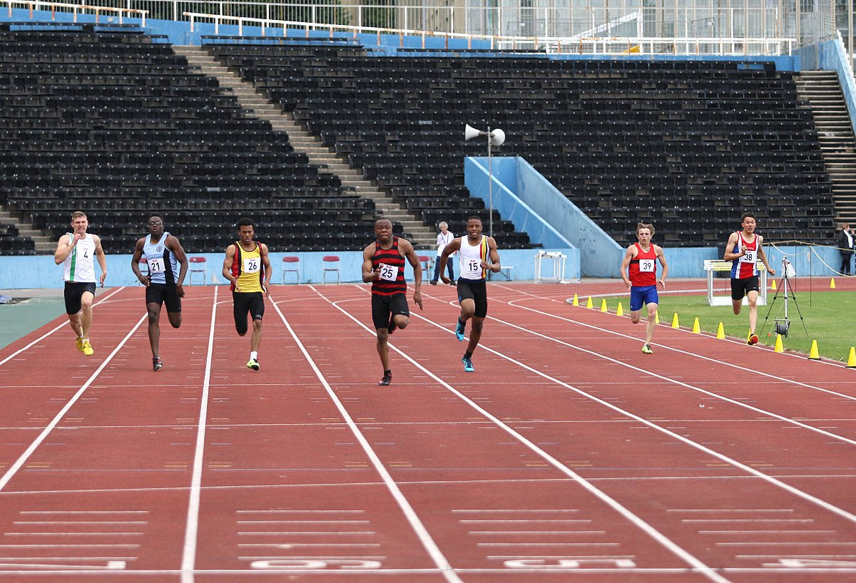 Powering up: Herne Hill Harriers' Marvin Popoola, second right, storms to victory in the 200m at the SEAA championships in Crystal Palace 									  All pictures: SP81799