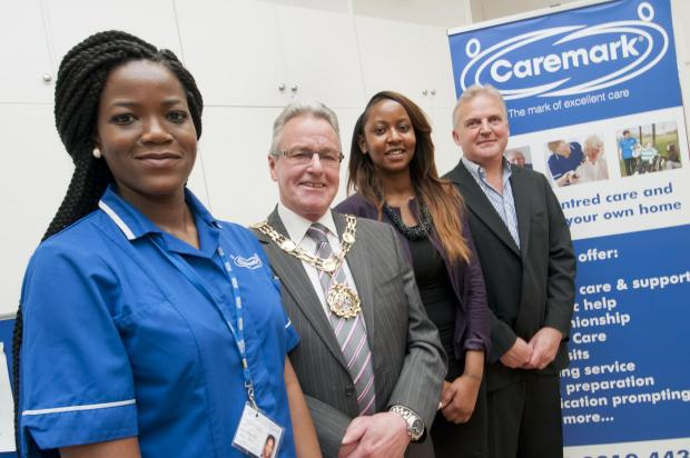 Former mayor Councillor Sean Brennan with Caremark workers