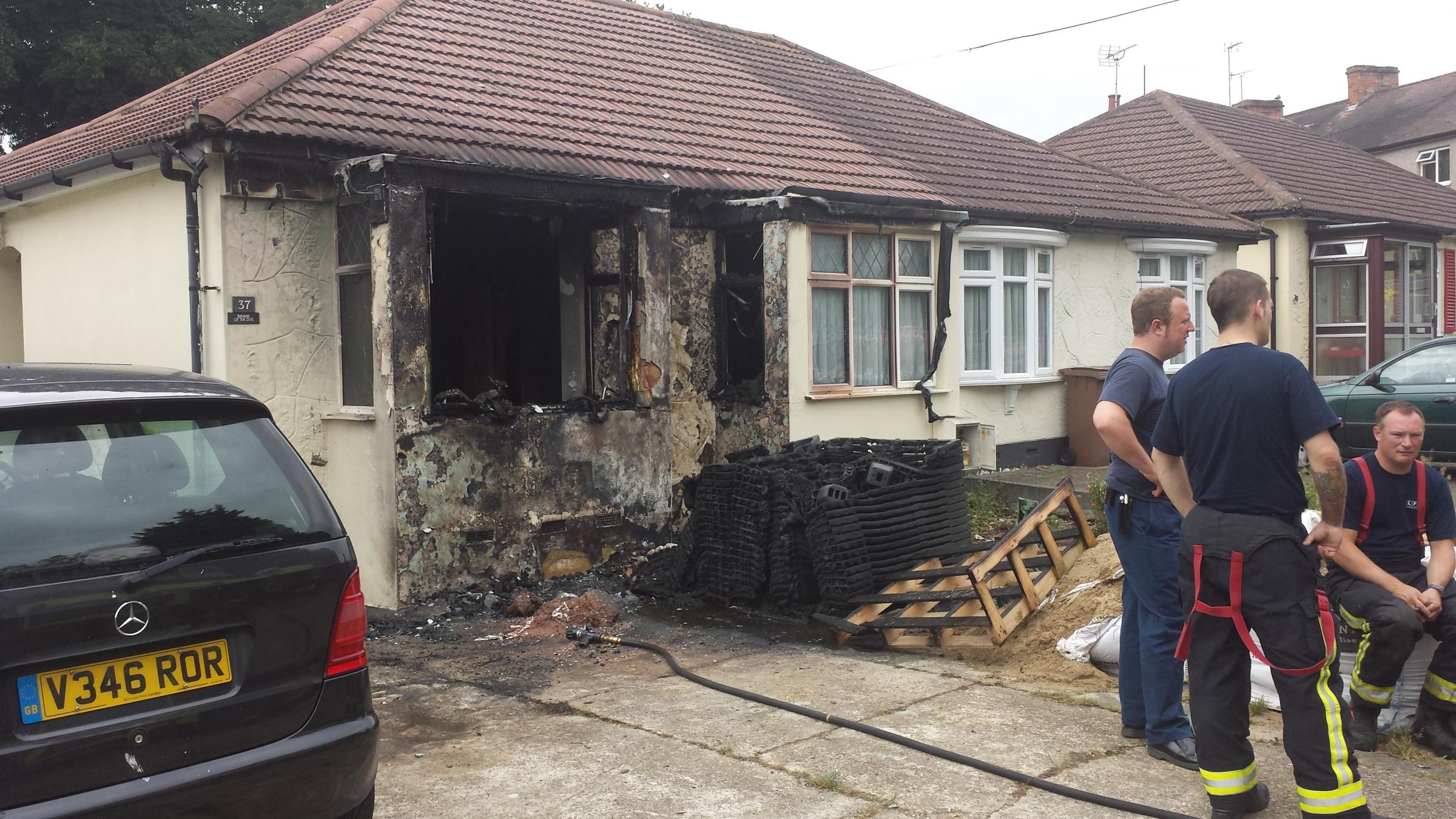 Fire guts house and melts car- 'if it happened at night I would be dead' says woman