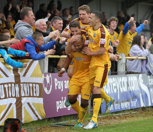 Sutton Guardian: Happy memories: Simon Downer is mobbed after scoring the 3-1 win over Ebbsfleet at the back end of last season               All pictures: Paul Loughlin