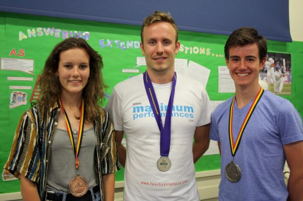 Sporting excellence: Students Ella Widdop-Gray (high jumper) and Calvin Hooper (rower) with Olympian Ed Sinclair