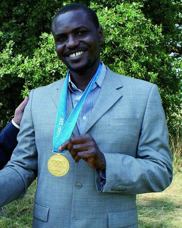 Sutton Guardian: Golden man: Fidelis Gadzama with his Olympic medal