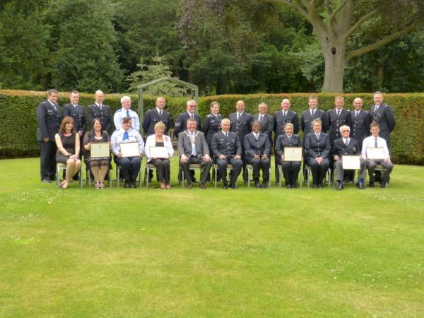 Sutton's borough commander Detective Chief Superintendent Guy Ferguson handed out commendations to 17 officers