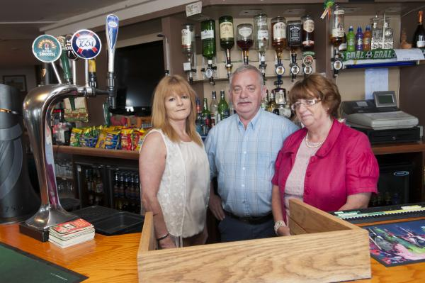 The Woodstok's landlords have vowed to keep the pub open as long as they can (L-R) Jane Dunne, Michael Dunne and Marion Healy