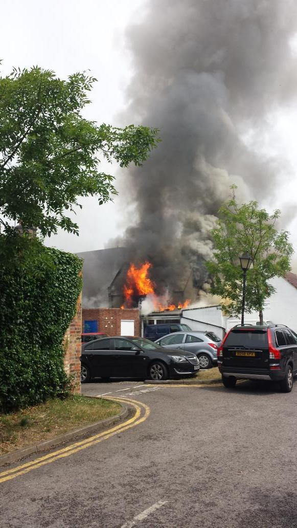 VIDEO: Fire rages behind Carshalton shops after strike action hampers response