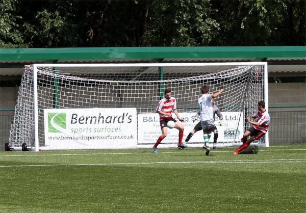 Moment of history: Ryan Fowler scores the first ever goal on Whyteleafe's new 3G pitch                 All pictures: SP81804