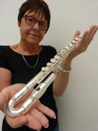 Gill Parks, criminal exhibits officer at Sutton police station, holds the instrument