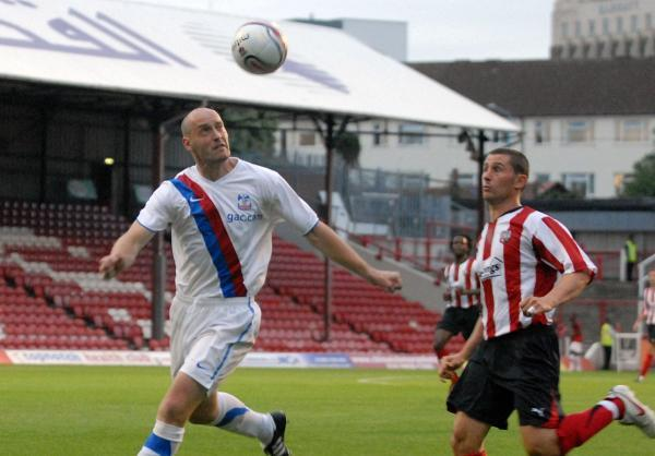 Dons new man: Adam Barrett, left, in his Palace days has signed on loan for Dons from Gillingham