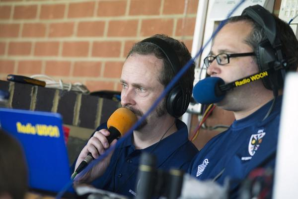 Just a mate on the mic (left to right): Rob Cornell and Geoff Hawley share banter during Dons 2-2 draw with Shrewsbury Town on Saturday 				              SP81999