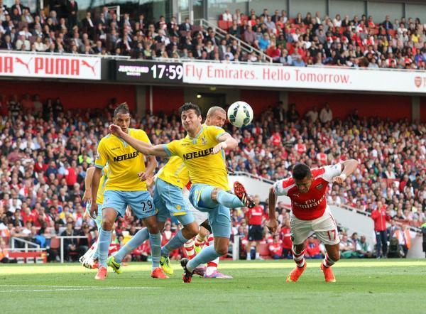 Blocker: Crystal Palace's Joel Ward gets in the way of an Alexis Sanchez header