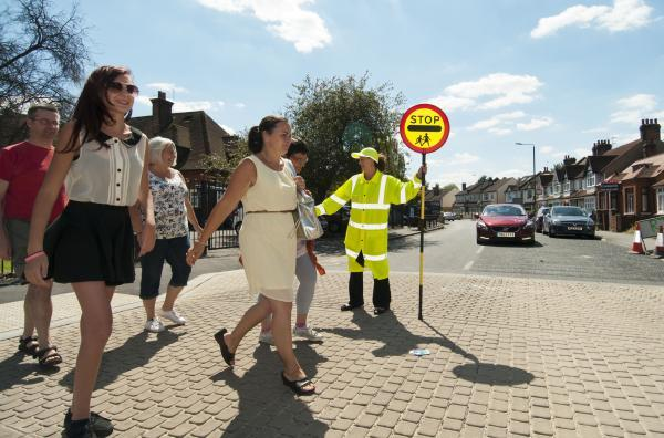 A lollipop lady in Hackbridge Road