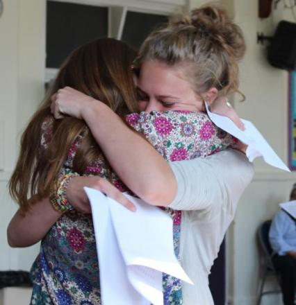 Students at Sutton High embrace after learning their results