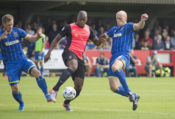 Last-gasp hero: Adam Barrett, right, hit a goal of the season contender to help guide the Dons into the next round of the Johnstone's Paint Trophy            SP86769