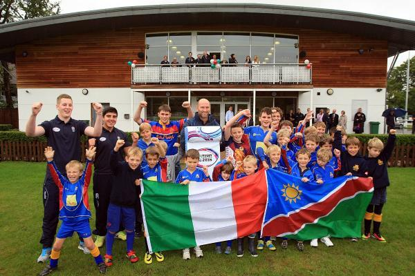 Great day: Cobham youngsters celebrate the news their club will be an official World Cup team base