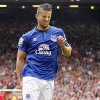 Sutton Guardian: Everton's Kevin Mirallas pulled up injured during the Merseyside derby