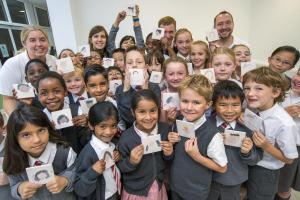 Primary school pupils paint tiles for huge artwork
