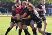 Stopped: Old Walcountians try to get to grips with the London Welsh Amateur attack at Old Deer Park