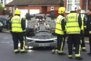 Firefighters were called to Cambridge Road in Carshalton after a car flipped over on to its roof