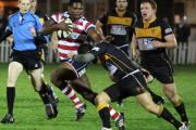 Keep clear: Joe Ajuwa fends off the attentions of an Esher man in Friday's win            Picture: David Whittam