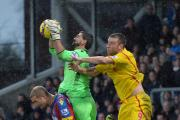 Selhurst favourite Julian Speroni gathers under pressure from Rickie Lambert. Picture by Keith Gillard.