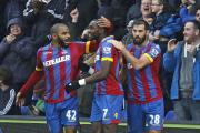 Man in the middle: Yannick Bolasie gets a pat on the back from Joe Ledley and Jason Puncheon after his shot from range hit the post and ended up in the back of the Liverpool net via Dwight Gayle's rebound              SP88596