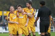 Welcome to the club: Jamie White, centre, gets congratulated by Glen Southam, left, and Ricky Wellard, right, after first goal for Sutton United in the 2-1 defeat at Bromley      Picture: Paul Loughlin