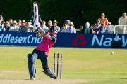 All action: Teddington Cricket Club's Middlesex professional Dawid Malan lets fly at Old Deer Park earlier this year