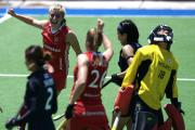 Moment of magic: Surbiton's Sarah Haycroft, top left, celebrates her first senior international goal for her country against Japan during the Champions Trophy in Argentina, where England finished fifth 	Picture: Frank Uijlenbroek