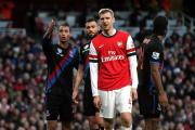 Old friends: Crystal Palace striker Marouane Chamakh and Arsenal defender Per Mertesacker