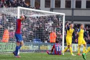 So close: Glenn Murray can only look on as his header rebounds off the woodwork in the last seconds of Crystal Palace's 2-1 defeat to Arsenal          All pictures: SP90013