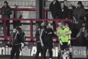 Did you see what happened?: Kingstonian goalkeeper Rob Tolfrey is led away in the aftermath of Monday's dramatic scenes  Picture: Fox in Box Productions