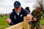 Hands on: Mike Gatting at Ashtead CC last year as part of the NatWest CricketForce weekend