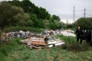 Rubbish dump: Travellers left a large amount of rubbish at the site which has been earmarked for a news school off London Road, near BedZed,